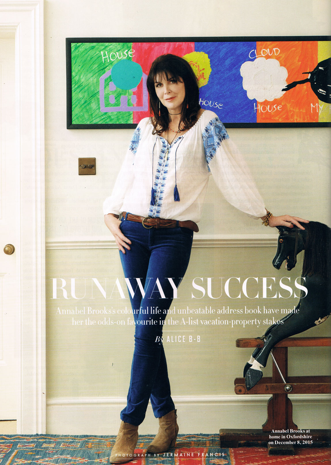 Annabel Brooks, owner of Avenue Property leaning on rocking horse